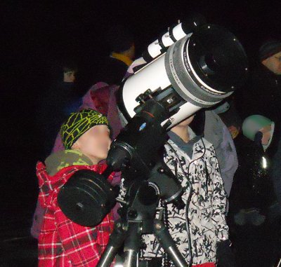 Picture of child at telescope