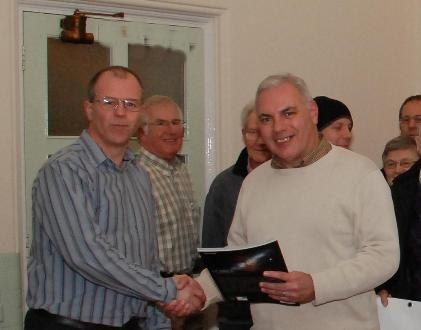Danny Thomas presenting a prize to Mark Janes