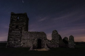 Photo: Night sky over the thousand-year-old Knowlton Church on Cranborne Chase (Nigel Ball)